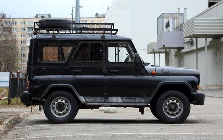 Black Russian jeep in the parking lot, Iskrovsky Prospekt, Saint Petersburg, Russia, April 2021