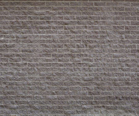 Plastered wall under a large gray brick Banco de Imagens