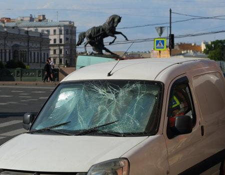 The broken cracked windscreen of a car, Nevsky Prospekt, Saint Petersburg, Russia, June 2021