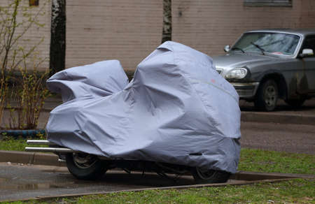 The motorcycle is covered with a cover