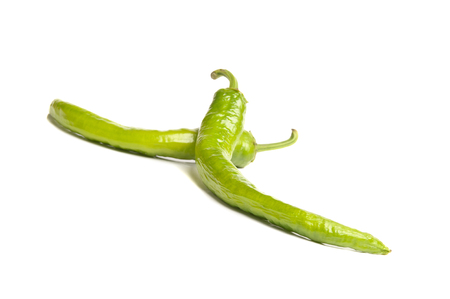 chiles picantes: closeup isolated green hot peppers