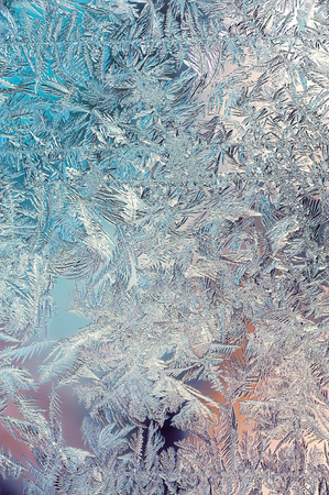 icy: Beautiful Closeup Winter Colorful Background With Icy Frost Patterns Stock Photo