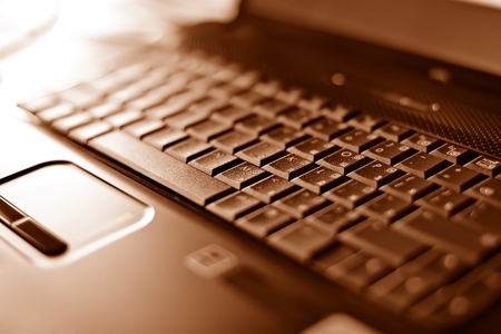communications tools: Abstract close-up laptop with shallow DOF