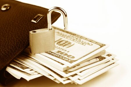 Business safety or financial protection or allow access. Heap of money in chain with open padlock isolated on white Stockfoto