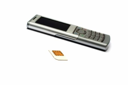 Phone and SIM card on a white background Stock Photo