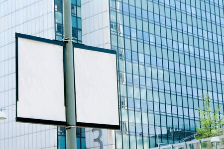 Outdoor billboards in the background of an office building