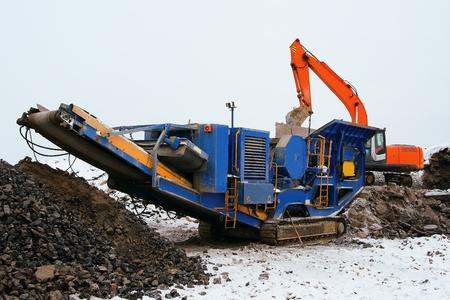 Machine for crushing stone construction waste
