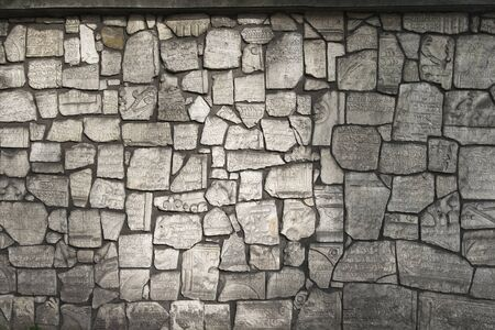 The wall is made from fragments of monuments in the Jewish cemetery Stock Photo - 11294395