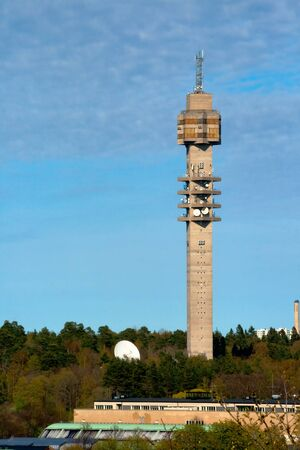 Spring Landscape with a television tower against a blue sky photo