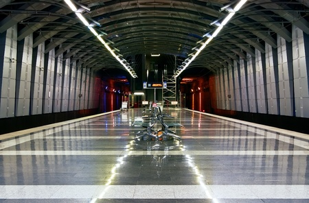 Moscow metro station with metal benches in the center