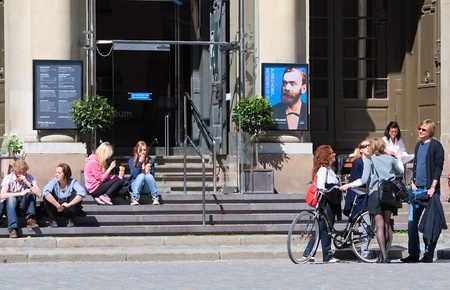 On the steps of the entrance to the Nobel Museum in Stockholm