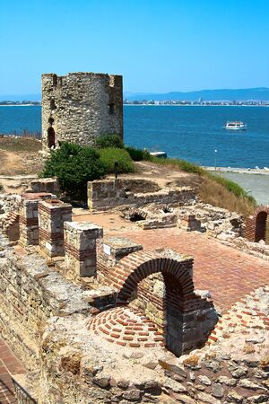 The ruins of the old stone mill and the ruins of a Byzantine basilica of the VI century  Nessebar  Bulgaria