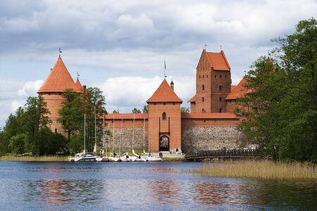 Landscape with yachts, boating lake and Trakai Castle photo