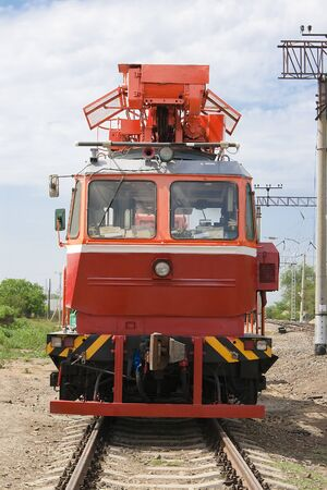 concomitant: Rail service vehicle repair power equipment