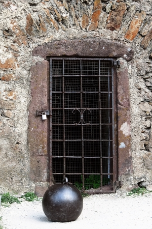 Grille on the door of the old tower in the castle Hochosterwitz photo
