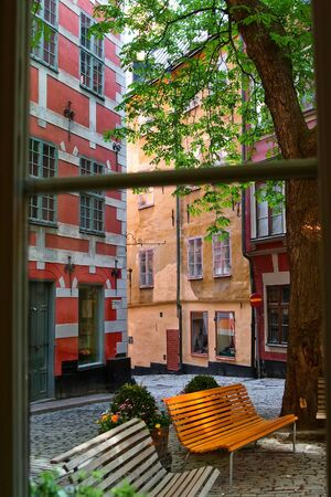 View from the window a small cafe on the patio in the old town  Stockholm  Sweden photo
