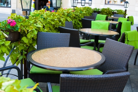 patio chair: Tables in the summer cafe in the street of the old city  Krakow