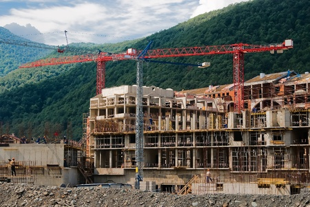 Construction of reinforced concrete building in the Caucasus Mountains Stock Photo