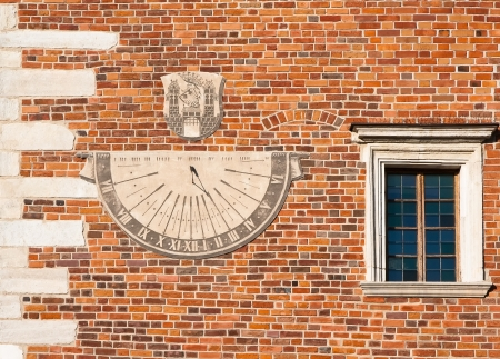 Sundial and a window in the tower in the center of Sandomierz  Poland