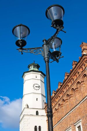 Antique street lamp against the City Hall