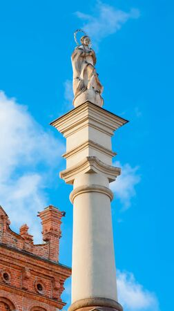 polska monument: A statue of the Virgin on a background of blue sky in front of the town hall in Sandomierz  Poland