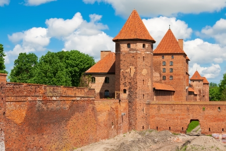 The wall and towers in lower park of the castle of Malbork in early spring. Poland Editorial