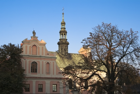 The bell tower of the church of St. Michael on the background of blue sky in the Polish town of Sandomierz Stock fotó