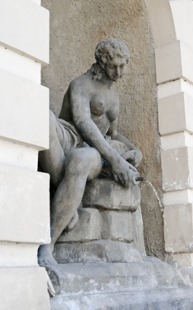 Sculpture-fountain in the form of nymphs, pouring water from a pitcher. Prague. Czech Republic Stock Photo