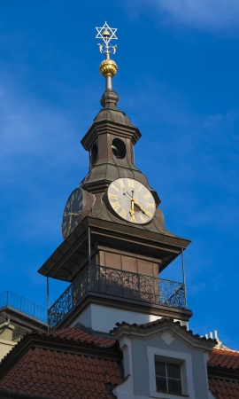 The Synagogue tower with clock in Prague photo