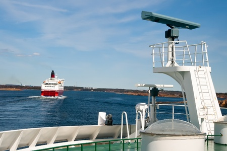 archipelago: Several large ferry and sail along the islands are close to the end point of travel Stock Photo