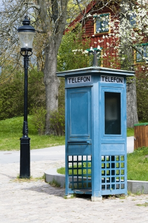 antique booth: Antique phone booth blue and old lantern