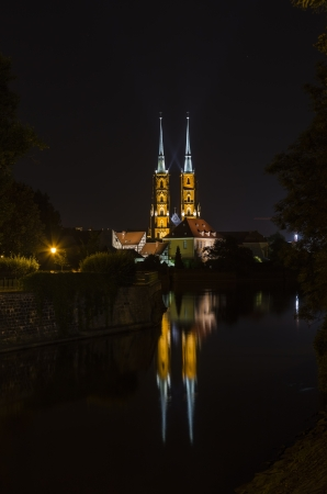 Cathedral of St  John the Baptist in the Tumskoe island in the dark  Wroclaw  Poland photo