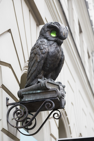 small sculpture of owl over the entrance to the building