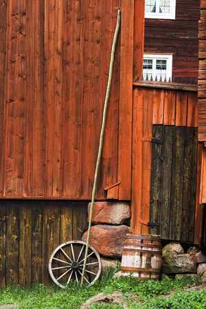 Attributes of rural life are against the wall of the barn photo