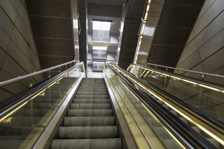 escalator in the metro with glass partitions