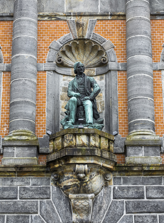 Statue on the facade of the West Norway Museum of Decorative Art