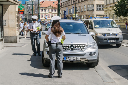 Prague, Czech Republic - May 10, 2011: Two policemen prescribed fee for parking on the street of Prague on 10 May 2014.