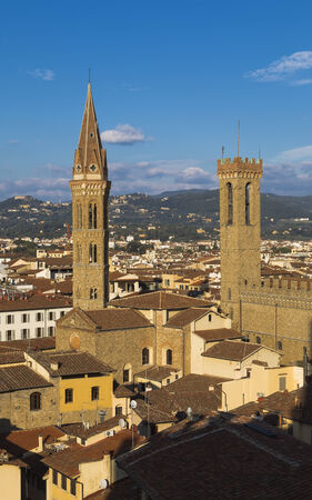 Church of the Badia Fiorentina and the tower of the National Museum Bargello in Florence. Italy. Editorial