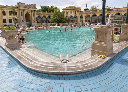 BUDAPEST, HUNGARY - MAY 05, 2014: Relax in the outdoor pool The Szechenyi spa complex Editorial