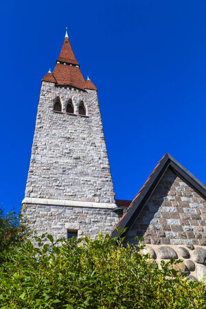 The tower of the cathedral in Tampere with a tiled roof. Finland