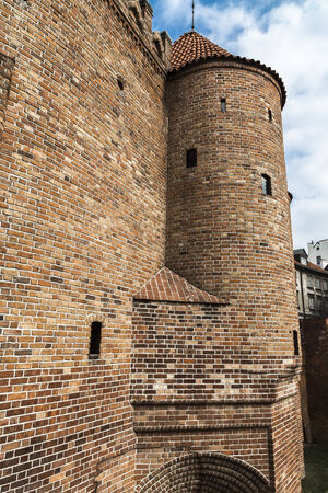 outpost: A fragment of the city walls and the Barbican in Warsaw. Poland