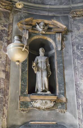 One of the sculptures in the Basilica - Santuario della Santissima Annunziata Stock Photo