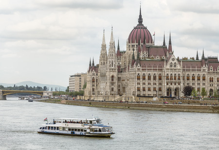 pleasure boat: Pleasure boat on the Danube river in front of the Hungarian Parliament. Budapest. Hungary Stock Photo
