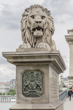 Sculpture of a lion on a chain bridge in Budapest. Hungary Stok Fotoğraf