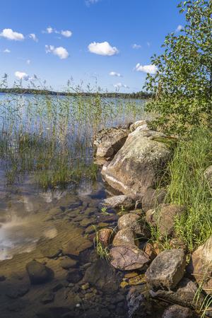 Rocky shore of the lake. Finland Stock Photo