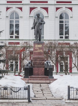 The monument to Vladimir Ilyich Lenin (Ulyanov) on the background of the building in winter. Vladimir. Russia