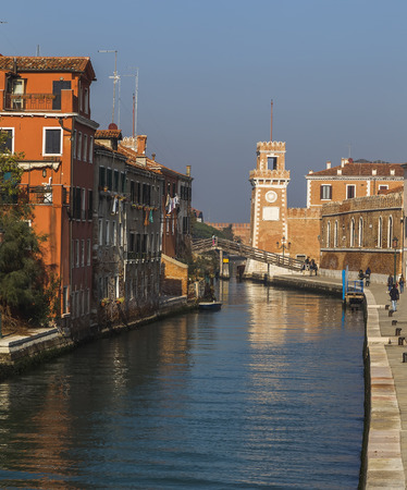 arsenal: One of the canals in Venice and the Arsenal Tower in the distance. Italy