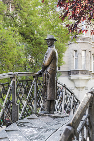 BUDAPEST, HUNGARY - MAY 05, 2014: Monument to Imre Nagy, standing on a metal bridge near the building of the Hungarian Parliament.