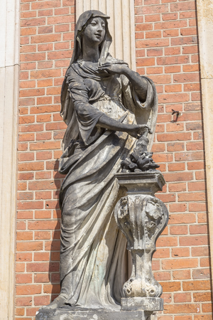 Sculpture near the brick wall of a new Sanssouci Palace. Potsdam. Germany