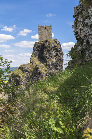 one of the two surviving towers of the castle Trosky in the Czech Republic